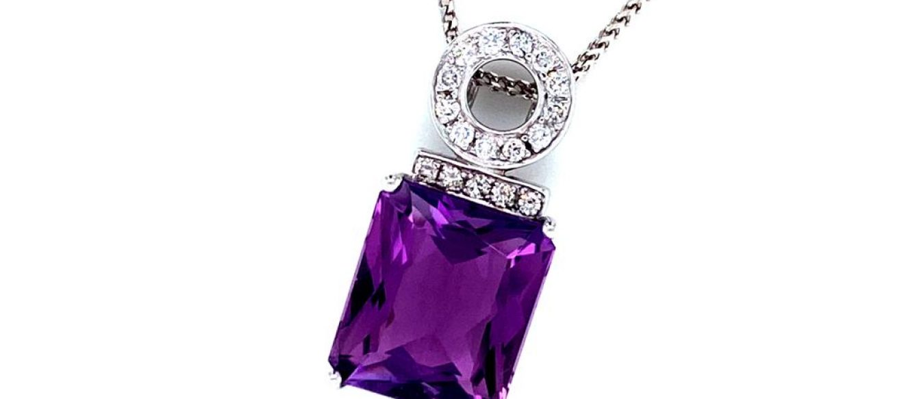 "18ct white gold diamond and amethyst pendant on 16"" 18ct white gold chain. Pendant is set with 0.24ct of round brilliant cut diamonds and one 'scissor cut' octagonal amethyst of 8.26ct priced at £2960.00"