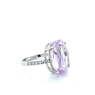 18ct white gold ring set with one large oval Brazilian french pink amethyst and 0.43ct of round brilliant cut diamonds priced at £2,340.00